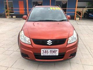 2011 Suzuki SX4 GYB MY10 Orange 6 Speed Manual Hatchback.
