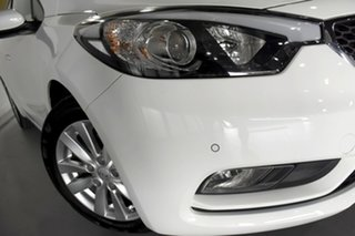 2015 Kia Cerato YD MY15 S Premium Clear White & Wheat Silver 6 Speed Automatic Hatchback.