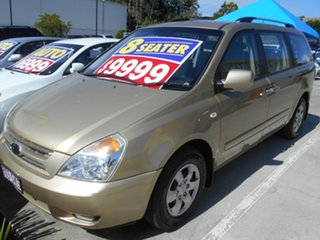 2010 Kia Grand Carnival VQ EXE Gold 5 Speed Sports Automatic Wagon.