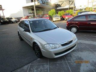 1999 Mazda 323 Astina Gold 4 Speed Automatic Hatchback.