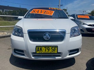 2006 Holden Barina TK White 5 Speed Manual Sedan.