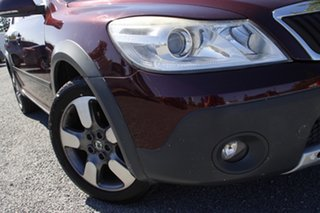 2011 Skoda Octavia 1Z MY11 Scout Premium DSG 103TDI Red/Black 6 Speed Sports Automatic Dual Clutch.