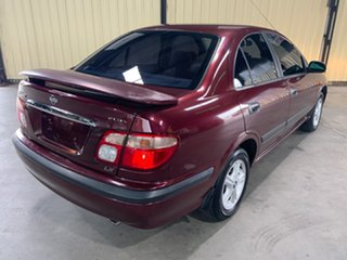 2002 Nissan Pulsar N16 LX Plus Maroon 5 Speed Manual Sedan.