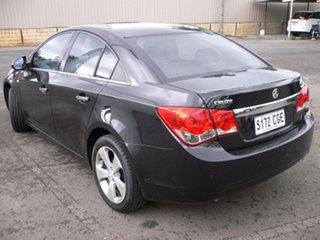 2009 Holden Cruze JG CDX Black 5 Speed Manual Sedan.