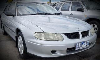 2002 Holden Commodore VX II Executive Silver 4 Speed Automatic Sedan.