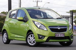 2015 Holden Barina Spark MJ MY15 CD Fresh Lime Green/black 4 Speed Automatic Hatchback.