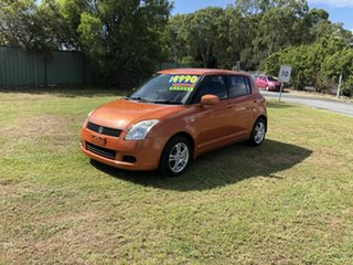 2005 Suzuki Swift RS415 GLX Orange 5 Speed Manual Hatchback.