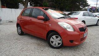 2006 Toyota Yaris NCP90R YR Orange 4 Speed Automatic Hatchback.