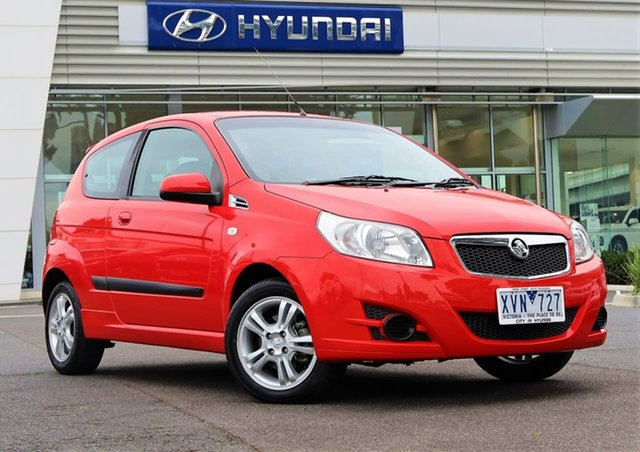 Used Holden Barina TK MY10 South Melbourne, 2010 Holden Barina TK MY10 Red 5 Speed Manual Hatchback