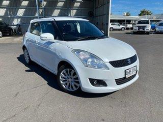2011 Suzuki Swift FZ GLX White 4 Speed Automatic Hatchback.