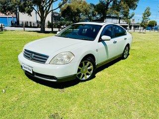 2004 Nissan Maxima J31 ST-L Pearl White 4 Speed Automatic Sedan.