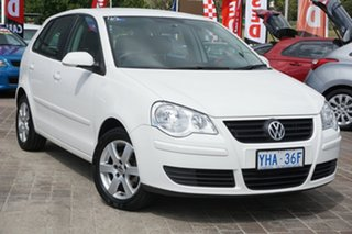 2010 Volkswagen Polo 6R 77TSI DSG Comfortline White 7 Speed Sports Automatic Dual Clutch Hatchback.