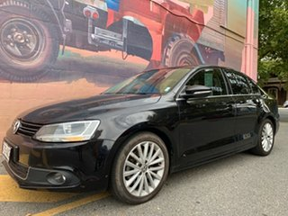 2012 Volkswagen Jetta 1B MY12.5 147TSI DSG Highline Black 6 Speed Sports Automatic Dual Clutch Sedan