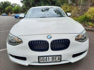 2014 BMW 1 Series F20 MY0314 116i Steptronic White 8 Speed Sports Automatic Hatchback.