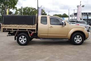 2008 Nissan Navara D40 ST-X King Cab Gold 5 Speed Automatic Cab Chassis.