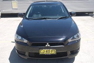 2010 Mitsubishi Lancer CJ MY10 ES Sportback Black 5 Speed Manual Hatchback.