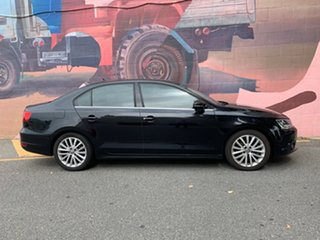 2012 Volkswagen Jetta 1B MY12.5 147TSI DSG Highline Black 6 Speed Sports Automatic Dual Clutch Sedan.