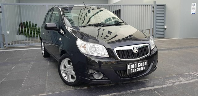 Used Holden Barina TK MY11 Southport, 2011 Holden Barina TK MY11 Black 4 Speed Automatic Hatchback
