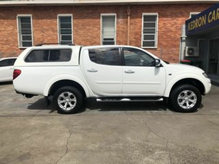2013 Mitsubishi Triton MN MY14 GLX-R Double Cab White 5 Speed Sports Automatic Utility