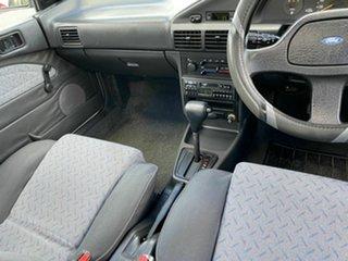 1994 Ford Laser KHII GL White 3 Speed Automatic Sedan.