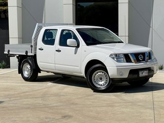 2013 Nissan Navara D40 S8 RX White 5 Speed Automatic Cab Chassis.