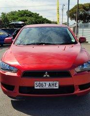 2010 Mitsubishi Lancer CJ MY11 ES Red 5 Speed Manual Sedan.