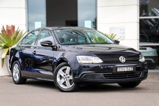 2012 Volkswagen Jetta 1B MY13 118TSI DSG Comfortline Black 7 Speed Sports Automatic Dual Clutch.
