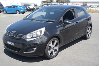 2011 Kia Rio UB MY12 SLi Black 6 Speed Sports Automatic Hatchback.