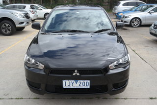 2013 Mitsubishi Lancer CJ MY14 ES Black 5 Speed Manual Sedan.