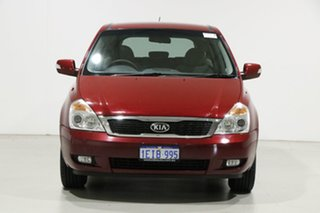 2013 Kia Grand Carnival VQ MY13 S Red 6 Speed Automatic Wagon.