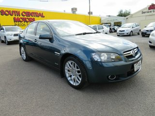 2009 Holden Berlina VE MY09.5 Dual Fuel Green 4 Speed Automatic Sedan.