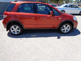2009 Suzuki SX4 GYA S Orange 4 Speed Automatic Hatchback.