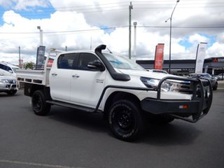 2016 Toyota Hilux GUN126R SR (4x4) Glacier White 6 Speed Automatic Dual Cab Chassis.