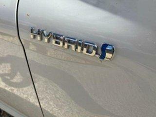 2019 Toyota Camry Hybrid Glacier White Sedan.