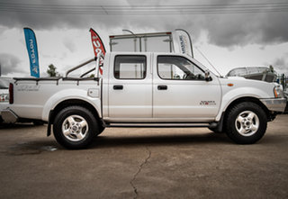 2013 Nissan Navara D22 Series 5 ST-R (4x4) Polar White 5 Speed Manual Dual Cab Pick-up.