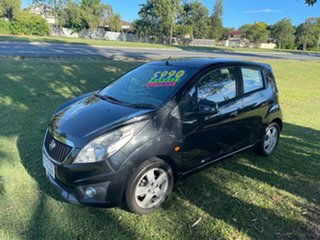 2010 Holden Barina Spark MJ MY11 CDX Black 5 Speed Manual Hatchback.