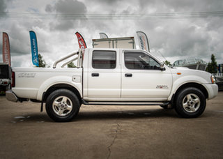 2012 Nissan Navara D22 Series 5 ST-R (4x4) Polar White 5 Speed Manual Dual Cab Pick-up.