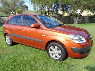 2009 Kia Rio JB MY07 EX Orange 4 Speed Automatic Hatchback.