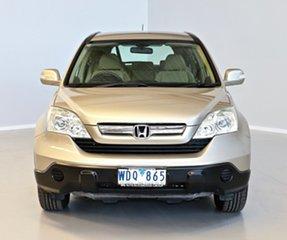 2007 Honda CR-V RE MY2007 4WD Gold 6 Speed Manual Wagon.