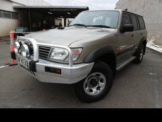 2001 Nissan Patrol GU II ST (4x4) Gold 4 Speed Automatic 4x4 Wagon.