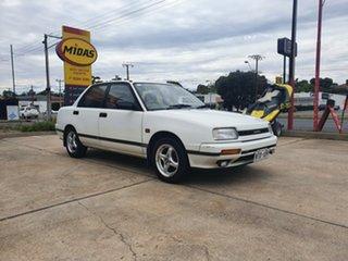 1992 Daihatsu Applause A101 Executive White 4 Speed Automatic Sedan.