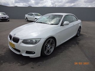 2011 BMW 325i E93 MY11 White 6 Speed Auto Steptronic Convertible.