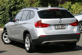 2011 BMW X1 E84 MY0911 sDrive18i Steptronic Titan Silver 6 Speed Sports Automatic Wagon.