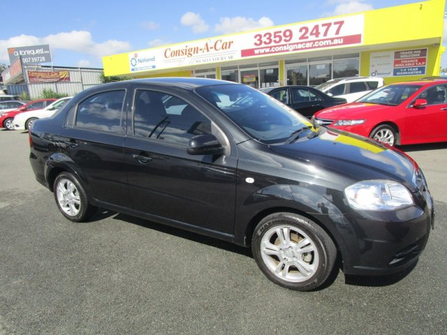 Used Holden Barina TK MY11 Kedron, 2010 Holden Barina TK MY11 Black 4 Speed Automatic Sedan