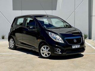 2011 Holden Barina Spark MJ MY11 CD Black 5 Speed Manual Hatchback.