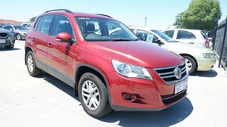 2010 Volkswagen Tiguan 5N MY10 125TSI 4MOTION Red 6 Speed Sports Automatic Wagon.
