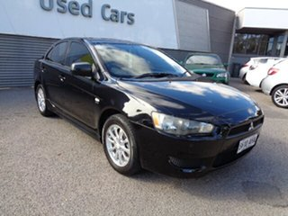 2010 Mitsubishi Lancer CJ MY10 Activ Black 5 Speed Manual Sedan.
