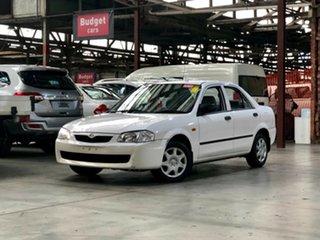 2000 Mazda 323 BJ Shades Protege White 4 Speed Automatic Sedan.