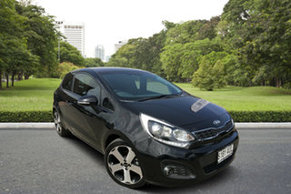 2011 Kia Rio UB MY12 SLS Black 6 Speed Manual Hatchback.