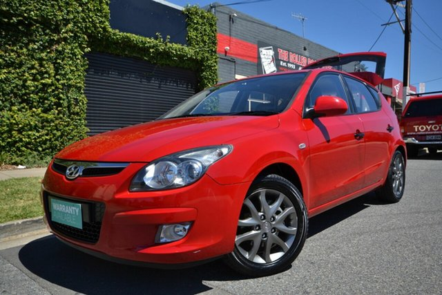 Used Hyundai i30 FD MY12 Trophy Blair Athol, 2012 Hyundai i30 FD MY12 Trophy Red 5 Speed Manual Hatchback